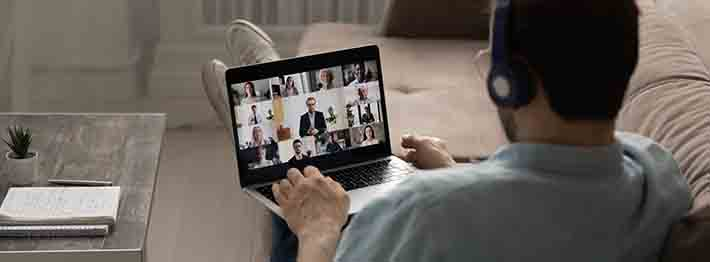 man attending virtual event on laptop