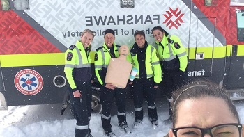 Fanshawe paramedic students standing in front of the College's ambulance