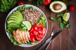 Bowl of whole grains, fruit and vegetables.
