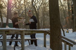 Students pouring coffee outdoors during the winter