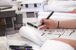 Creating a new building's floor plan using marker and paper.