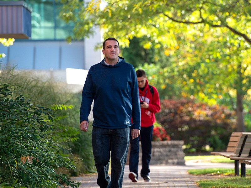 Man walking on campus at Fanshawe College