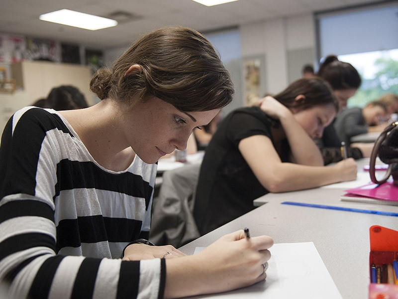 A student writes a test in class