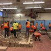 Construction class – Students starting paving exercise.