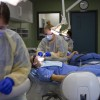 Students in the dental clinic/lab practice using dental tools