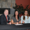 Peter Devlin, Robyn van Oirschot and Candace Lickers sign the protocol