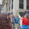 A tour guide provides valuable architectural background for students that focus on the importance of heritage preservation.