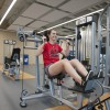Student uses weight machine in Student Wellness Centre