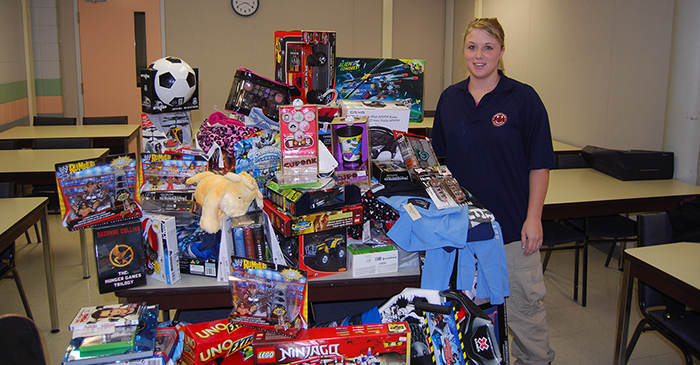 Photo of Oxford Campus student with Angel Tree gifts