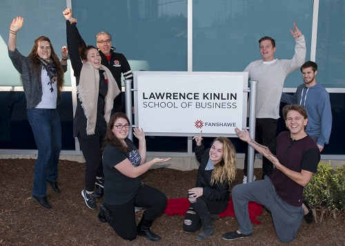 Celebrating the new signage at the Lawrence Kinlin School of Business