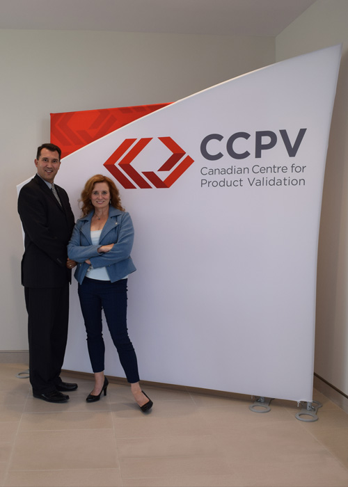 CEO Ben Cecil (L) shows Film Fest ED Dorothy Downs around CCPV