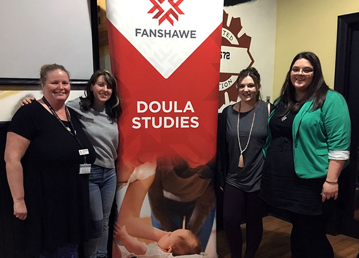 Photo of Doula Studies professor and students