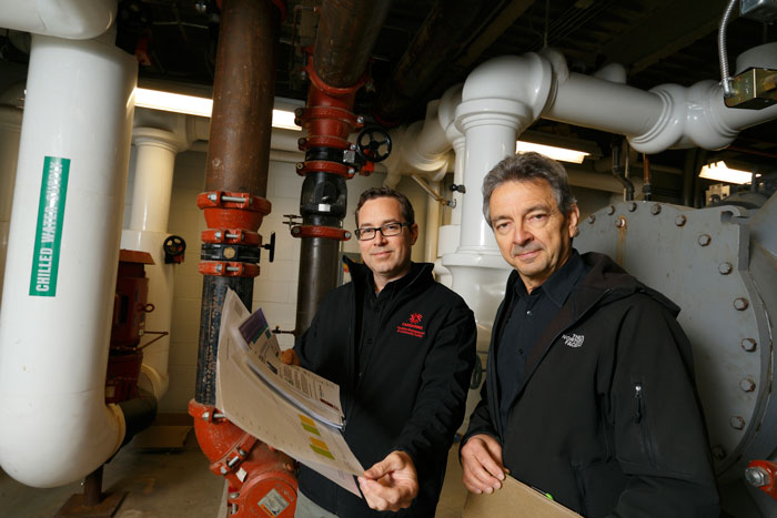 Fanshawe's Nathan Gerber (L) collaborates on energy-saving measures with London Hydro's Mike Isber