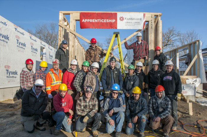 Fanshawe Coordinator Jim Leslie (far right, middle row) and his carpenter apprentices work hard for Habitat