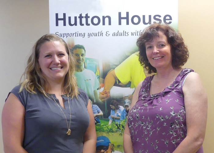 Autism researcher Carmen Hall (L) visits Hutton House executive director Jeanette Dutot