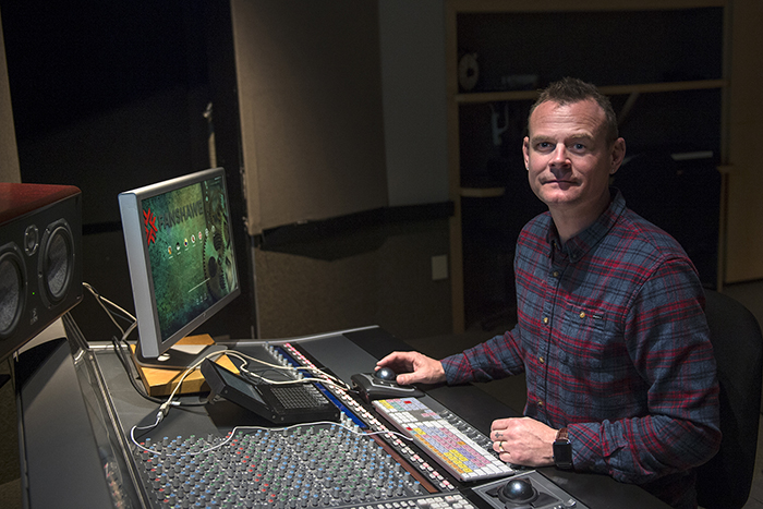 Photo of program coordinator Dan Brodbeck at a sound mixing board