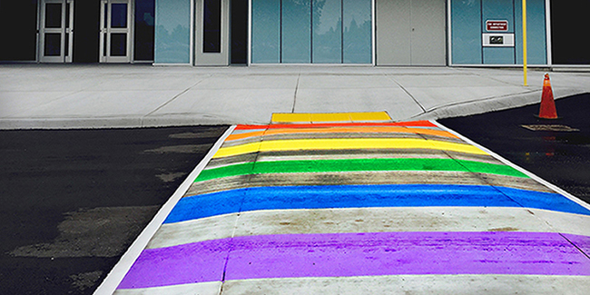 Ground level view of rainbow pride crosswalk at London Campus