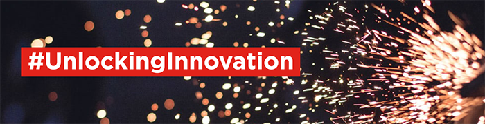 #UnlockingInnovation with background of flying sparks