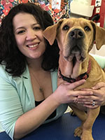 Photo of Alicia Kendrick and canine client.